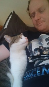 Loki likes to wake up Hubby Jim by using him as a pillow